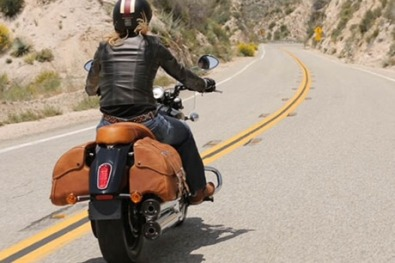 Indian Scout with brown leather saddlebags and pillions seat