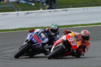 Jorge Lorenzo and Marc Marquez in action motorcycle insurance