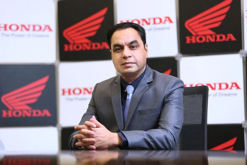 A headshot of Sales and Marketing Director of Honda Motorcycle & Scooter India Pvt. Ltd., Yadvinder Singh Guleria