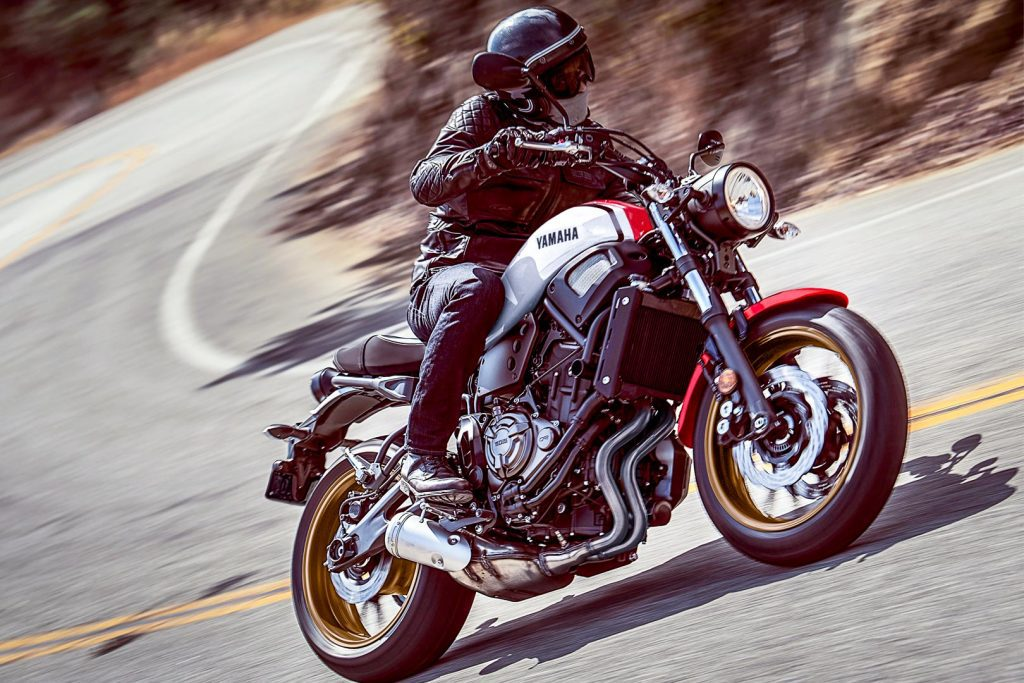 a side view of a rider turning a The Yamaha 2020 XSR700
