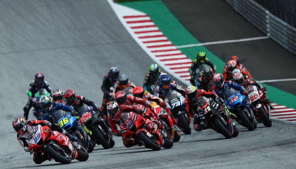a view of the pile of riders powering through the turns of the Round 10 MotoGP at the Styrian GP 2021