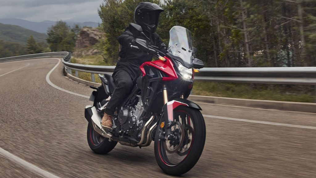 A view of a rider enjoying the new 2022 Honda CB500X in Grand Prix Red