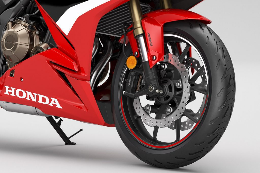 A first close-up view of the 2022 CR500R, front wheel.
