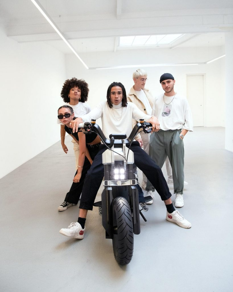A group of models featuring the new BMW CE 02 concept scooter