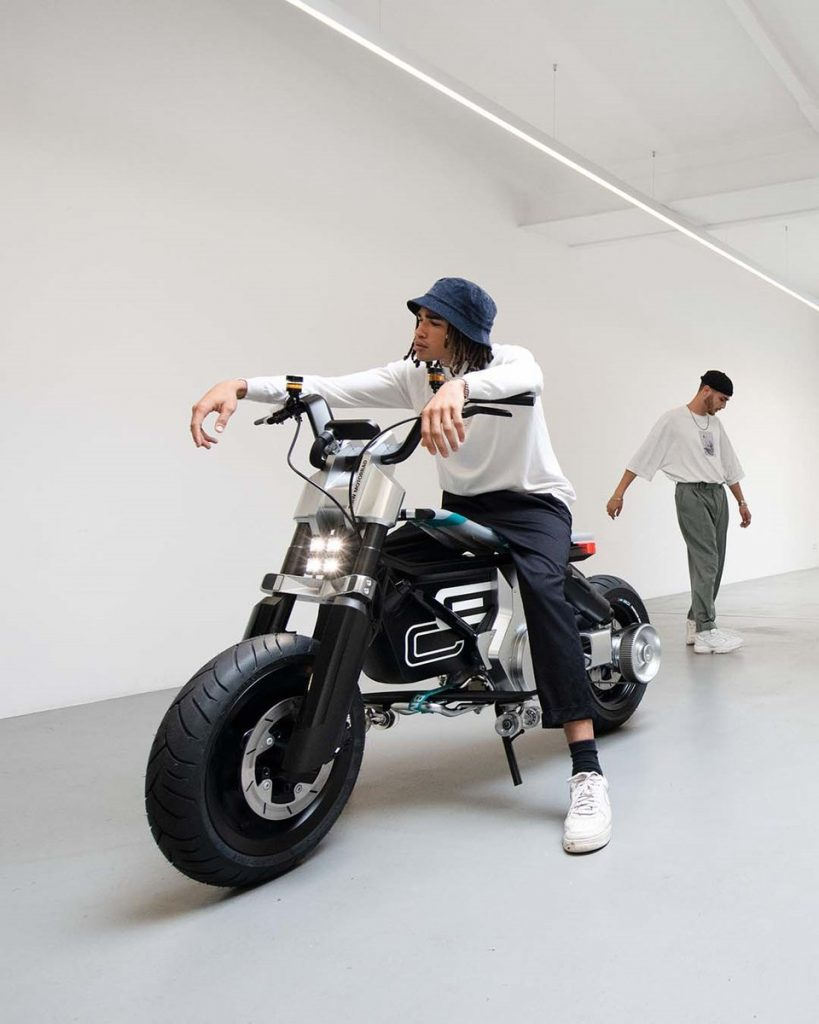 A model featuring the new BMW CE 02 concept scooter