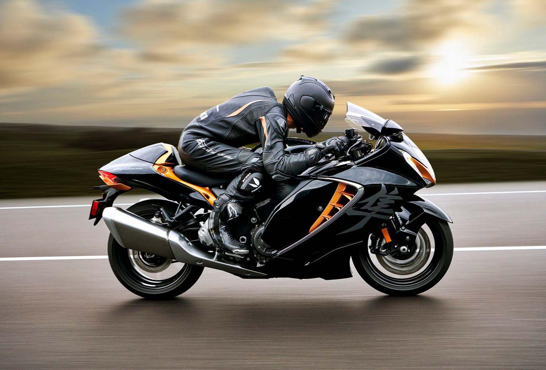 A rider on a Suzuki Hayabusa motorcycle speeds past the camera